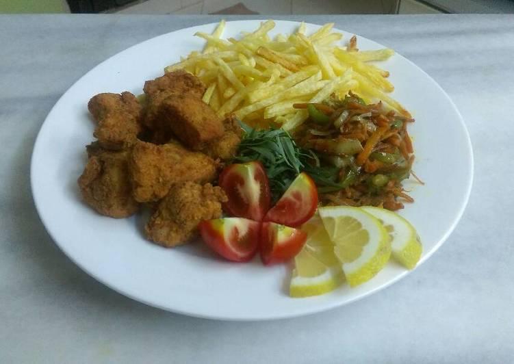 الصورة الرئيسية لوصفةناجت دجاج مع الخضراوات المقلية اللذيذة